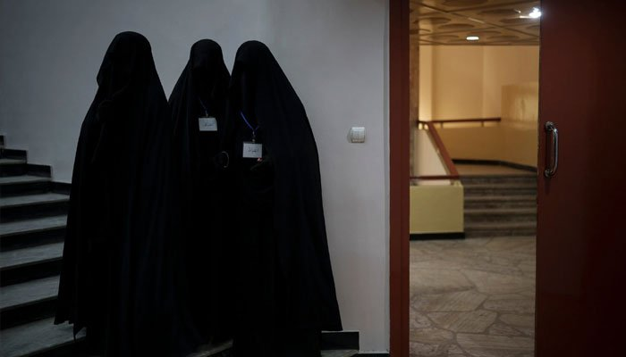 Female students standing inside an Afghan university. Photo AP