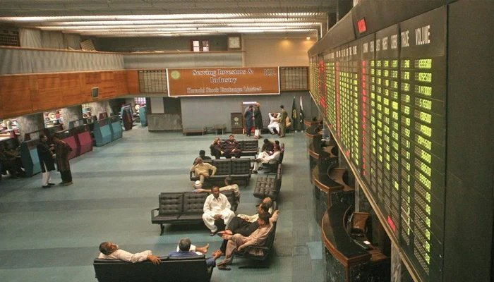 Investors sitting in the main hall of the Pakistan Stock Exchange. — AFP