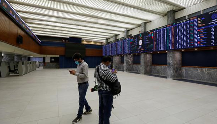 Two people can be seen standing in the main hall of the Pakistan Stock Exchange. — Reuters/File