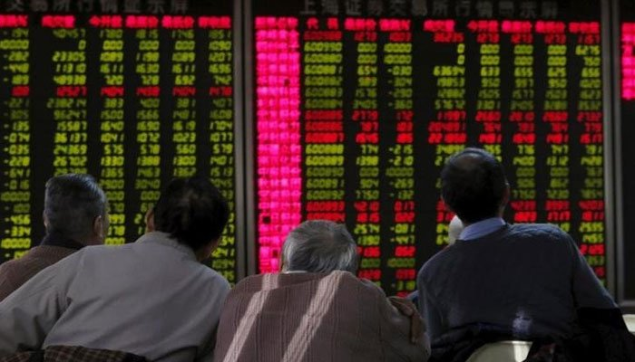 Investors can be seen looking at the stock board. — Reuters/File