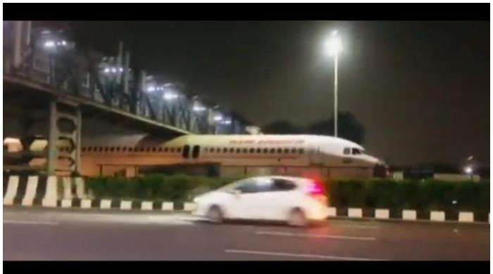 Watch: Indian aircraft stuck under overhead bridge in Delhi