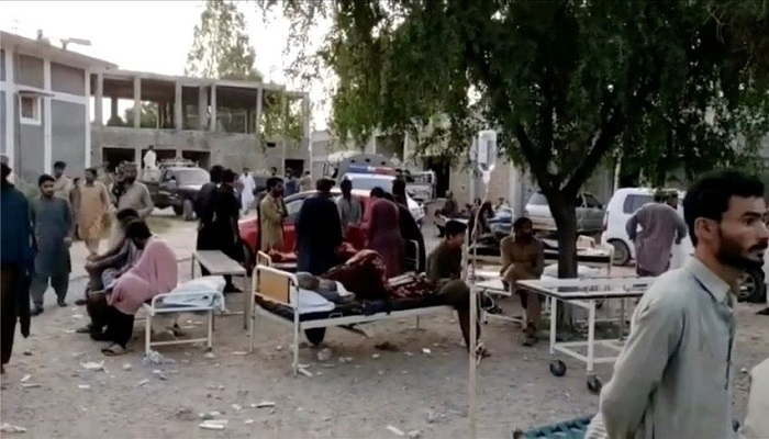 People gather outside a hospital following an earthquake in Harnai, Balochistan, Pakistan, October 7, 2021, in this still image obtained from video. Courtesy of QuettaVoice.com / Social Media via Reuters
