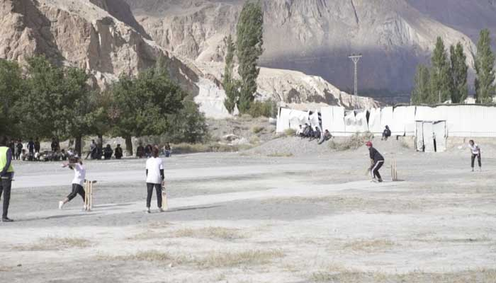An ongoing cricket match during the tournament in Gilgit.