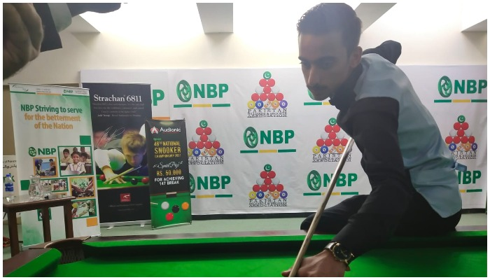 Ahsan Ramzan playing snooker. Photo provided by the reporter.