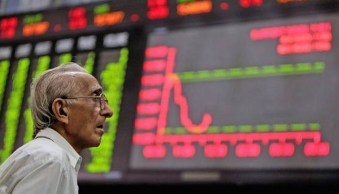 A dealer is worriedly looking at the stock board at the Pakistan Stock Exchange. — AFP/ File