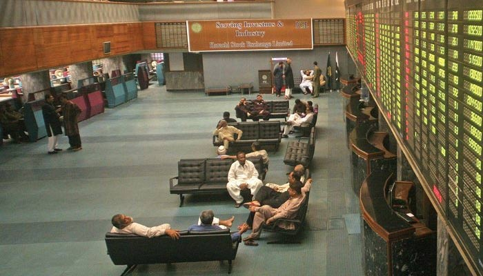 Investors and traders are sitting in the main hall of Pakistan Stock Exchange. — AFP/File