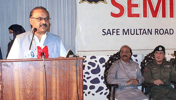 SAPM Malik Amir Dogar addresses a road safety seminar organised by City Traffic Police in Multan on August 7, 2021. — APP/File