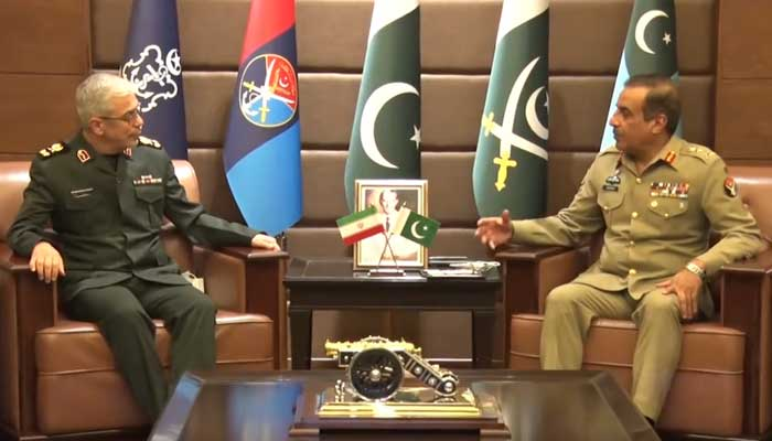 Irans Chief of General Staff of Armed Forces Maj Gen Mohammad Bagheri (L) and Chairman Joint Chiefs of Staff Committee Gen Nadeem Raza exchanging views of mutual interest at the Joint Staff Headquarters in Rawalpindi on October 13, 2021. — ISPR