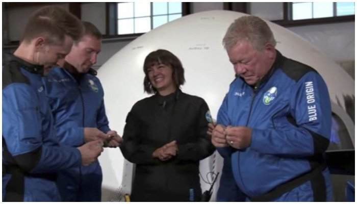 Star Trek actor William Shatner is presented with challenge coins along with former NASA engineer Chris Boshuizen, clinical research entrepreneur Glen de Vries and Blue Origin vice president and engineer Audrey Powers before their suborbital flight on Blue Origins New Shepard mission NS-18 near Van Horn, Texas, the US in a still image from video broadcast October 13, 2021. Blue Origin/Handout via Reuters