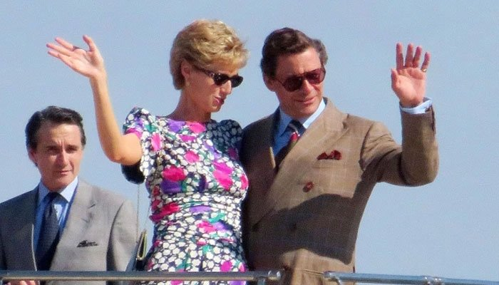 Elizabeth Debicki looking like a spitting image of Princess Diana as she can be seen waving with Dominic West's Prince Charles