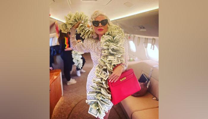 Lady Gaga mesmerises in boa made from $100 bills