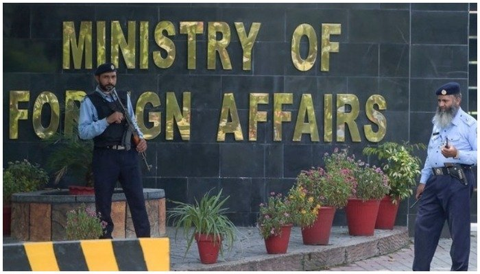 Security guards stand outside the Ministry of Foreign Affairs in Islamabad. — AFP