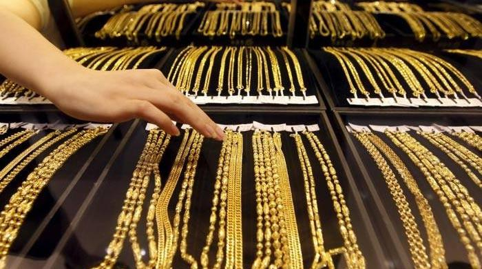 Gold retreats in line with international market
