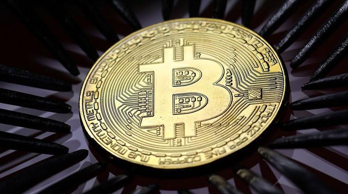Bitcoin tops $60,000 on US fund approval hopes