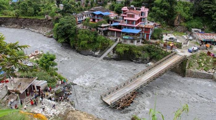 Nepal floods and landslides kill at least 77