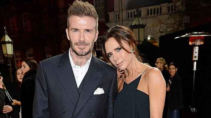 Victoria Beckham looks ultra glamorous as she enjoys family dinner with husband David and daughter Harper
