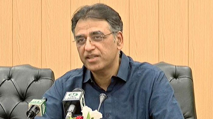 COVID-19 vaccination drive needs improvement in Karachi, Hyderabad: Asad Umar
